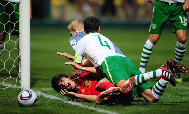 Alvaro Morata (Bottom) of Spain is tackled by John Egan (R) and Aaron McCarey of Ireland during their UEFA European Under-19 Championship football match, near the village of Chiajna village, outside of Bucharest, on July 29, 2011. AFP PHOTO/DANIEL MIHAILESCU (Photo credit should read DANIEL MIHAILESCU/AFP/Getty Images)