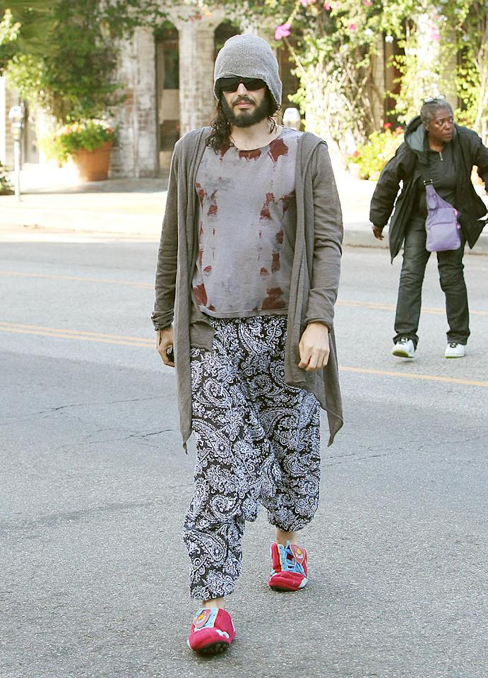 In a dirty-looking T-shirt, raggedy sweater, and mismatched paisley-print pants, Russell Brand blended in with a group of homeless people he kindly brought to breakfast in West Hollywood. We'll give him a fashion pass this time since he was doing such a good deed! (9/27/2012)