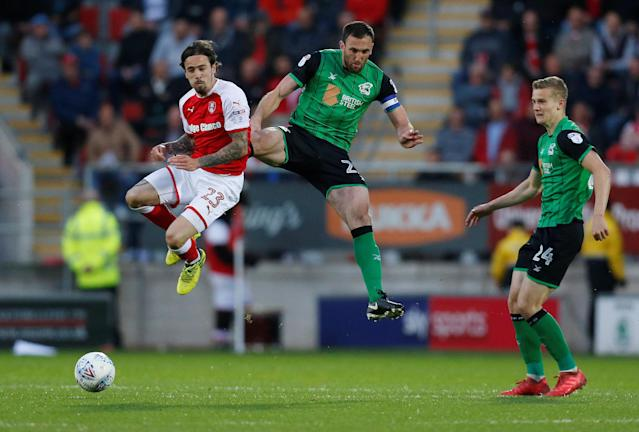 "Soccer Football - League One Play Off Semi Final Second Leg - Rotherham United vs Scunthorpe United - AESSEAL New York Stadium, Rotherham, Britain - May 16, 2018 Rotherham United's Ryan Williams in action with Scunthorpe United's Rory McArdle Action Images/Ed Sykes EDITORIAL USE ONLY. No use with unauthorized audio, video, data, fixture lists, club/league logos or ""live"" services. Online in-match use limited to 75 images, no video emulation. No use in betting, games or single club/league/player publications. Please contact your account representative for further details."