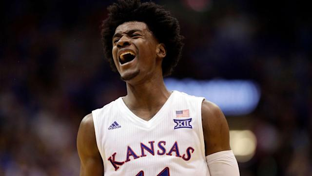 The Kansas freshman signed with former NBA player B.J. Armstrong of Wasserman Media Group.