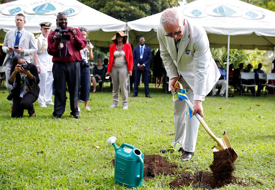 KINGSTOWN, SAINT VINCENT AND THE GRENADINES - MARCH 20: Prince Charles, Prince of Wales plants a tree during his visit to the Botanical Gardens during a visit to St. Vincent and the Grenadines on March 20, 2019 in Kingstown, St. Vincent and the Grenadines. (Photo by Phil Noble – WPA Pool/Getty Images)