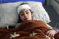 An injured girl lies in a hospital bed after a car bomb attack in Herat province, west of Kabul, Afghanistan, Saturday, March 13, 2021. A powerful car bomb killed at least eight people and injured 47 in Afghanistan's western Herat province, officials said Saturday. (AP Photo/Hamed Sarfarazi)