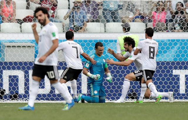 Soccer Football - World Cup - Group A - Saudi Arabia vs Egypt - Volgograd Arena, Volgograd, Russia - June 25, 2018 Egypt's Ahmed Fathy, Ahmed Hegazi and Tarek Hamed celebrate with Essam El-Hadary after he saved a penalty from Saudi Arabia's Fahad Al-Muwallad (not pictured) REUTERS/Ueslei Marcelino