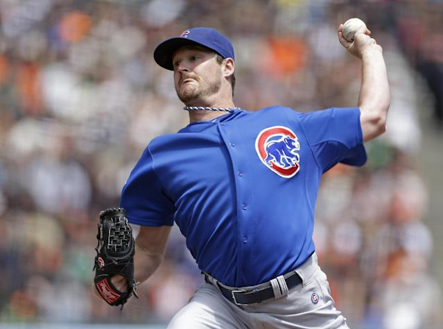 Chicago Cubs starting pitcher Travis Wood throws against the San Francisco Giants during the first inning of their baseball game on Sunday, July 28, 2013, in San Francisco. (AP Photo/Eric Risberg)