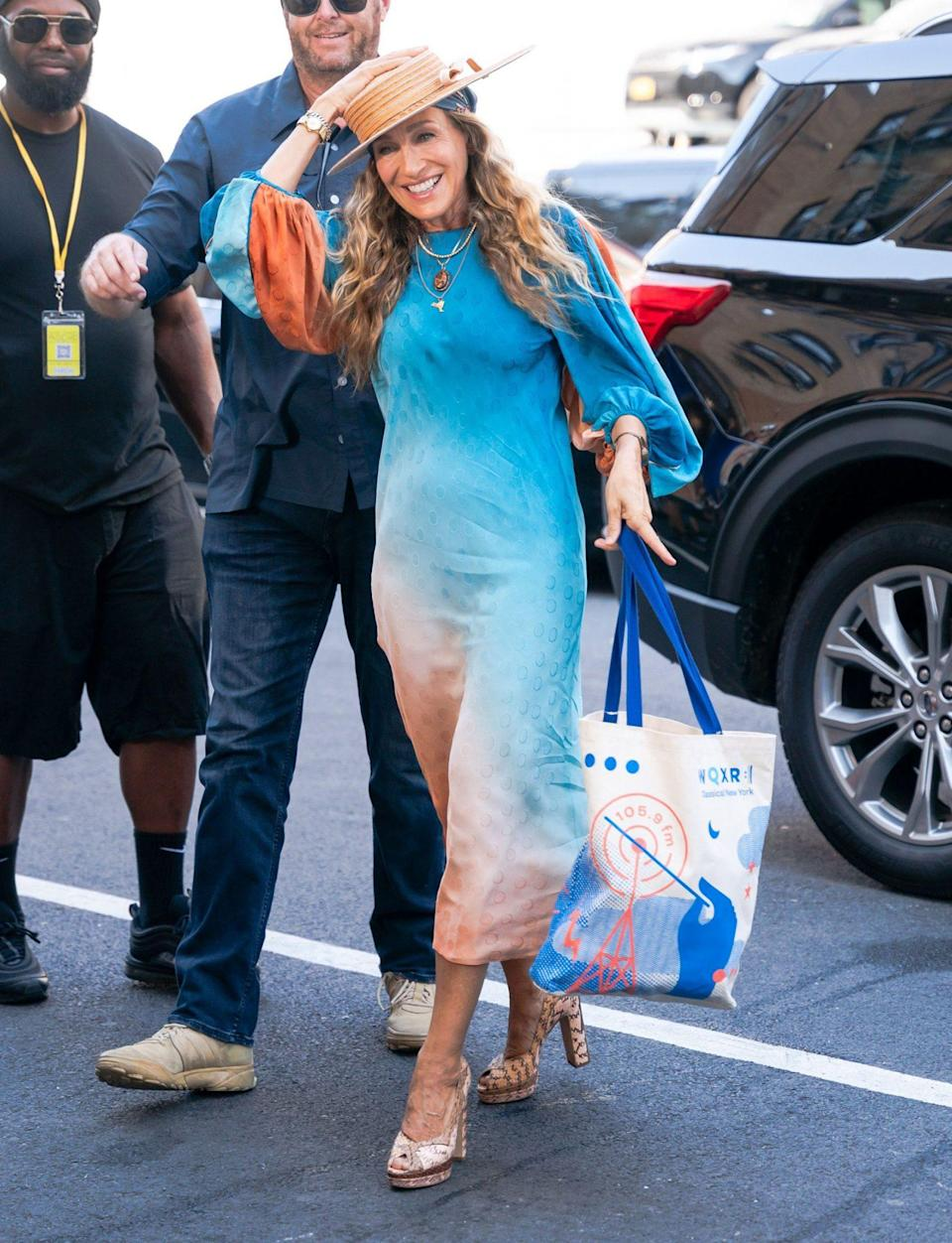 <p>Sarah Jessica Parker keeps a hold of her hat as she arrives on the set of<i> And Just Like That...</i> on August 26 in N.Y.C. </p>
