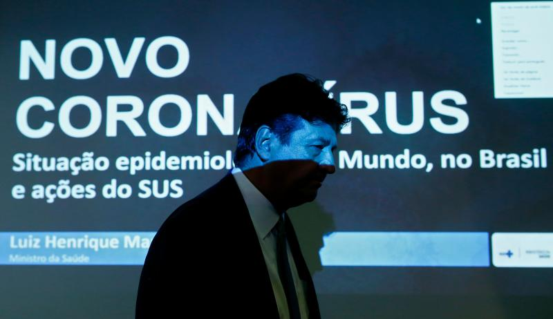 Brazilian Health Minister Luiz Henrique Mandetta arrives for a press conference on the evacuation of Brazilian citizens from the region affected by the coronavirus in China, at the Ministry of Health building in Brasilia on February 3, 2020. - A group of Brazilians sent a video from Wuhan, the epicenter of the coronavirus outbreak, asking President Jair Bolsonaro for help to return home. (Photo by Sergio LIMA / AFP) (Photo by SERGIO LIMA/AFP via Getty Images)