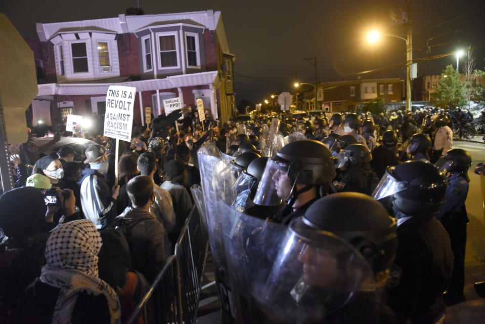 Protesters face off with police during a demonstration Tuesday, Oct. 27, 2020, in Philadelphia