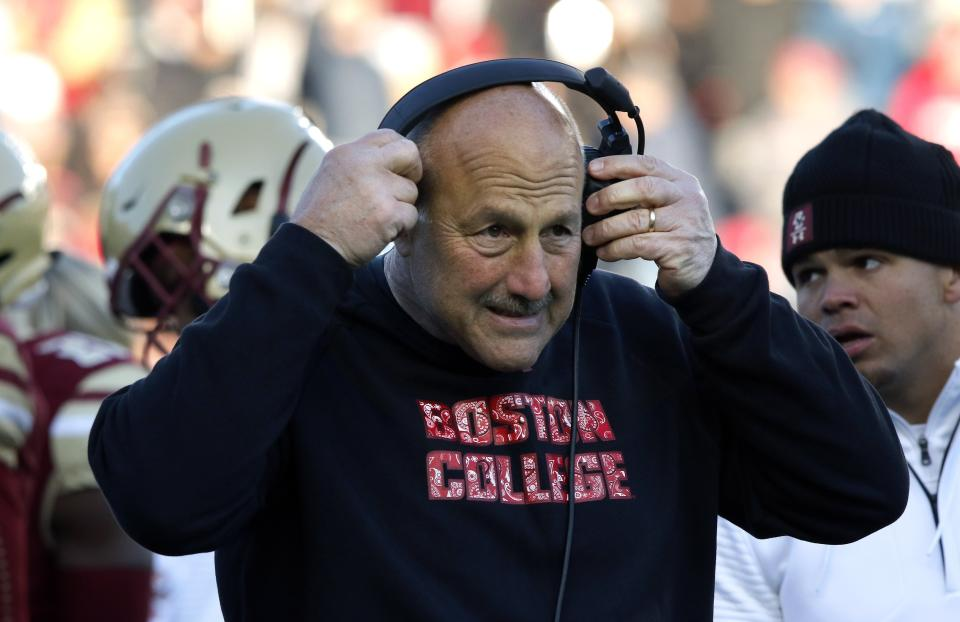 Boston College head coach Steve Addazio adjusts his headset on the sideline in the second half of a game against Florida State on Nov. 9. (AP)