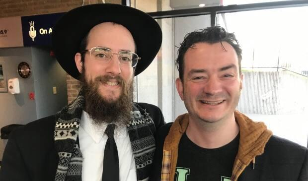 Rabbi Chanan Chernitsky (left) and Jonathan Richler, seen in this file photo, say Passover is an important time to pass on Jewish traditions and teachings. (Paula Gale/CBC - image credit)