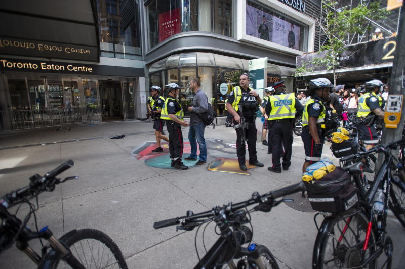 Toronto Police secure a crime scene after shots were fired during the Toronto Raptors NBA basketball championship parade in Toronto, Monday, June 17, 2019. (Andrew Lahodynskyj/The Canadian Press via AP)