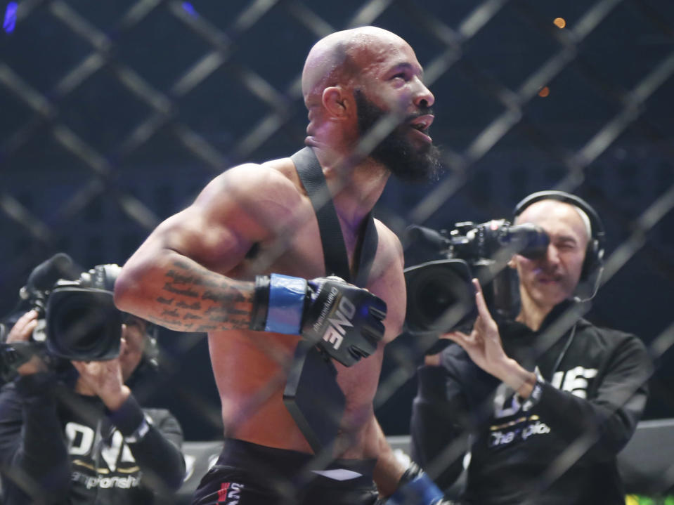 FILE - Mixed Martial Arts fighter Demetrious Johnson celebrates after defeating Japan's Yuya Wakamatsu in a flyweight world grand prix quarterfinal One Championship bout in Tokyo, in this Sunday, March 31, 2019, file photo. Demetrious Johnson and Eddie Alvarez won UFC championships before leaving their native U.S. to pursue another title overseas. Their home fans will get to see their next fights in Singapore thanks to One Championship's new series of fight cards on TNT. (AP Photo/Koji Sasahara, File)