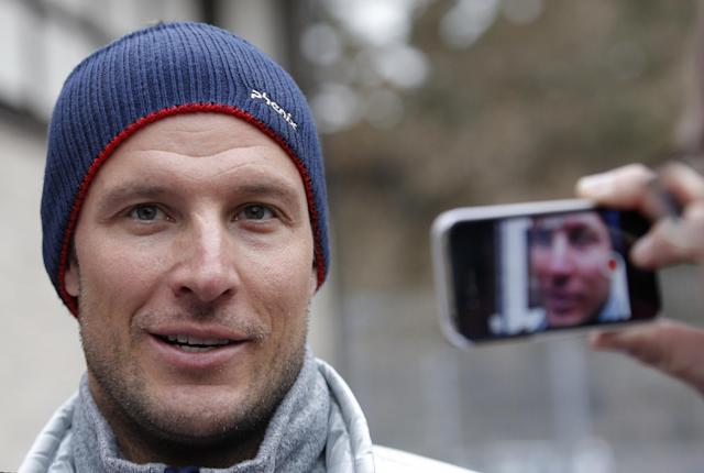 Norway's Aksel Lund Svindal addresses members of the media at the Sochi 2014 Winter Olympics, Monday, Feb. 17, 2014, in Krasnaya Polyana, Russia. Svindal is leaving the Olympics because he has problems with allergies and fatigue, the Norwegian men's Alpine skiing coach said Monday. (AP Photo/Christophe Ena)