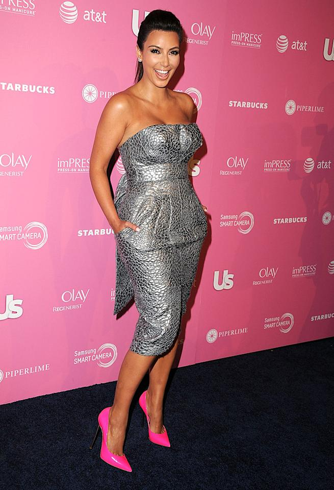 <i>Us Weekly</i> celebrated the most stylish stars in Tinseltown at its annual Hot Hollywood party, which took place at trendy Greystone Manor Supperclub in West Hollywood. Leading the pack? None other than Kim Kardashian, whose flair for fashion landed her a centerfold in the celebrity magazine. For the bash she picked some popping pink heels to complement her gray strapless dress. (4/18/2012)
