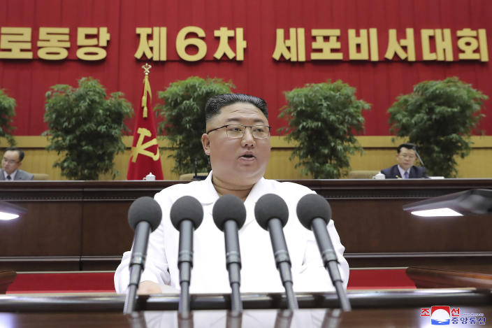 """In this photo provided by the North Korean government, North Korean leader Kim Jong Un delivers a closing speech at the Sixth Conference of Cell Secretaries of the Workers' Party of Korea in Pyongyang, North Korea, Thursday, April 8, 2021. Independent journalists were not given access to cover the event depicted in this image distributed by the North Korean government. The content of this image is as provided and cannot be independently verified. Korean language watermark on image as provided by source reads: """"KCNA"""" which is the abbreviation for Korean Central News Agency. (Korean Central News Agency/Korea News Service via AP)"""