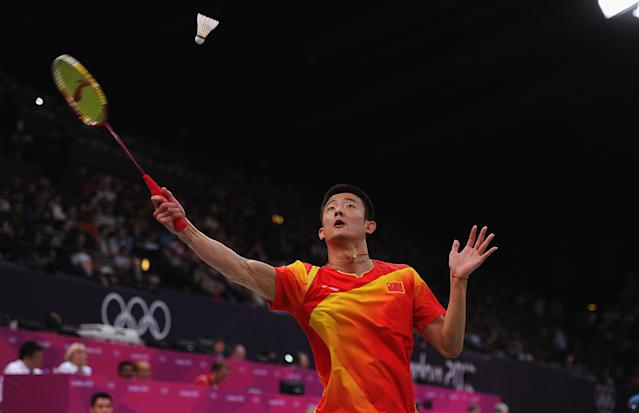 LONDON, ENGLAND - AUGUST 01: Long Chen of China returns against Wing Ki Wong of Hing Kong, China during their Men's Singles Badminton on Day 5 of the London 2012 Olympic Games at Wembley Arena at Wembley Arena on August 1, 2012 in London, England. (Photo by Michael Regan/Getty Images)