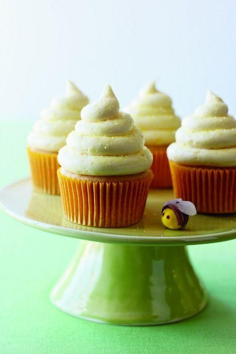 """<p>Guests will be buzzing about these fluffy cupcakes, which have grated lemon zest, lemon juice and honey not only in the batter, but in the luscious frosting as well. Add a little sparkle by finishing them with a sprinkling of sanding sugar or a candy bee.</p><p><strong><a href=""""https://www.womansday.com/food-recipes/food-drinks/recipes/a11157/lemon-honey-cupcakes-recipe-122603/"""" rel=""""nofollow noopener"""" target=""""_blank"""" data-ylk=""""slk:Get the recipe."""" class=""""link rapid-noclick-resp"""">Get the recipe.</a></strong></p>"""