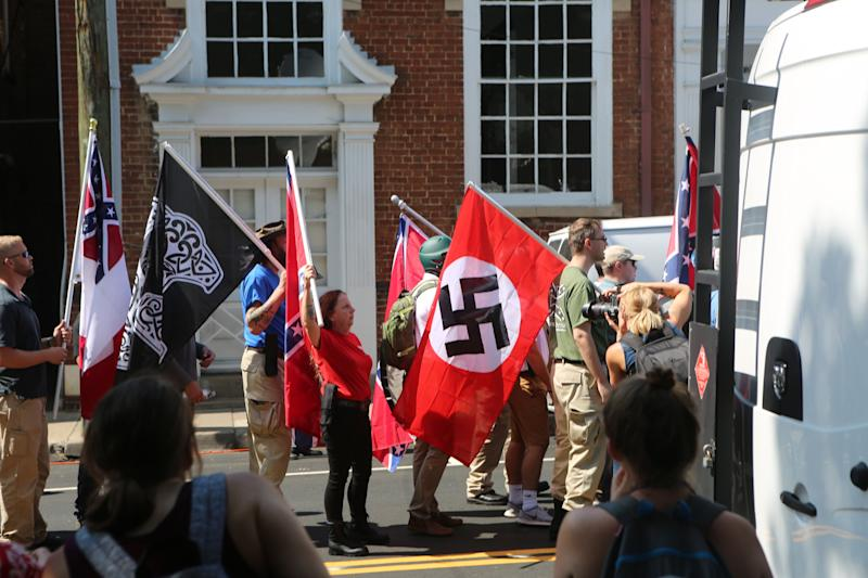 "A Nazi flag flies during the ""Unite the Right"" white supremacist rally in Charlottesville, Virginia, on Aug. 12, 2017.  (Photo: Andy Campbell / HuffPost)"