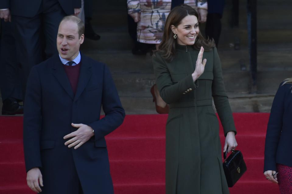 Britain's Prince William, left, smiles as Kate Duchess of Cambridge waves to the crowd after their meeting with the members of the public at Centenary Square in Bradford northern England, Wednesday, Jan. 15, 2020. (AP Photo/Rui Vieira)
