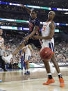 Auburn forward Horace Spencer, left, fights for a loose ball with Virginia forward Mamadi Diakite during the first half in the semifinals of the Final Four NCAA college basketball tournament, Saturday, April 6, 2019, in Minneapolis. (AP Photo/David J. Phillip)