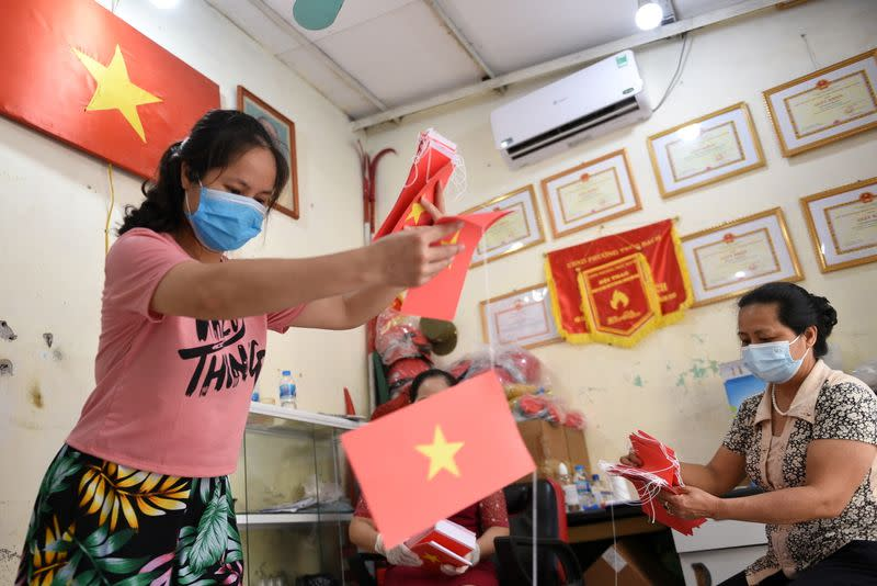 FILE PHOTO: Local officials prepare a polling station ahead of upcoming elections in Hanoi, Vietnam
