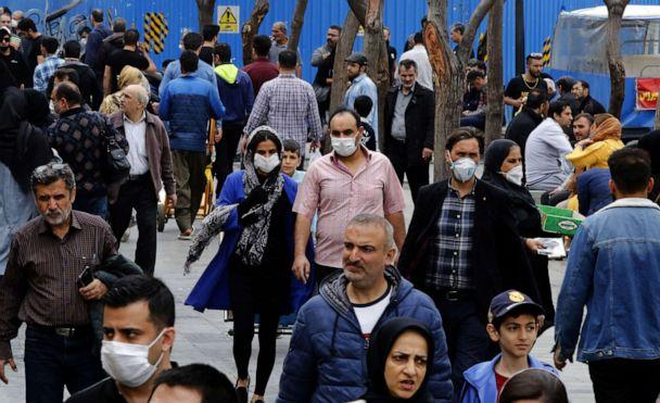 PHOTO: Iranians, some wearing protective masks, gather inside the capital Tehran's grand bazaar during a pandemic of the novel coronavirus on March 18, 2020. (AFP via Getty Images)