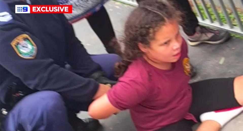 A nine-year-old girl is handcuffed by police after suffering an episode at school.