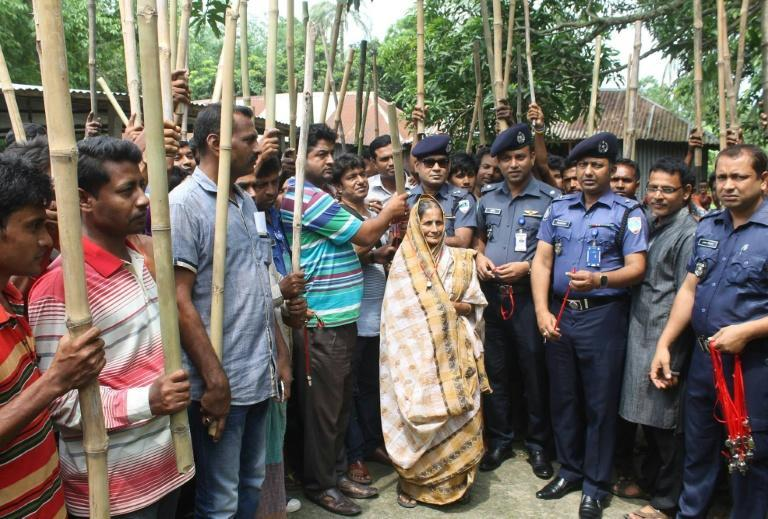 Police in western Bangladesh in mid-June 2016 armed villagers with bamboo sticks and whistles in an effort to deter Islamist militants from attacking people of minority faiths