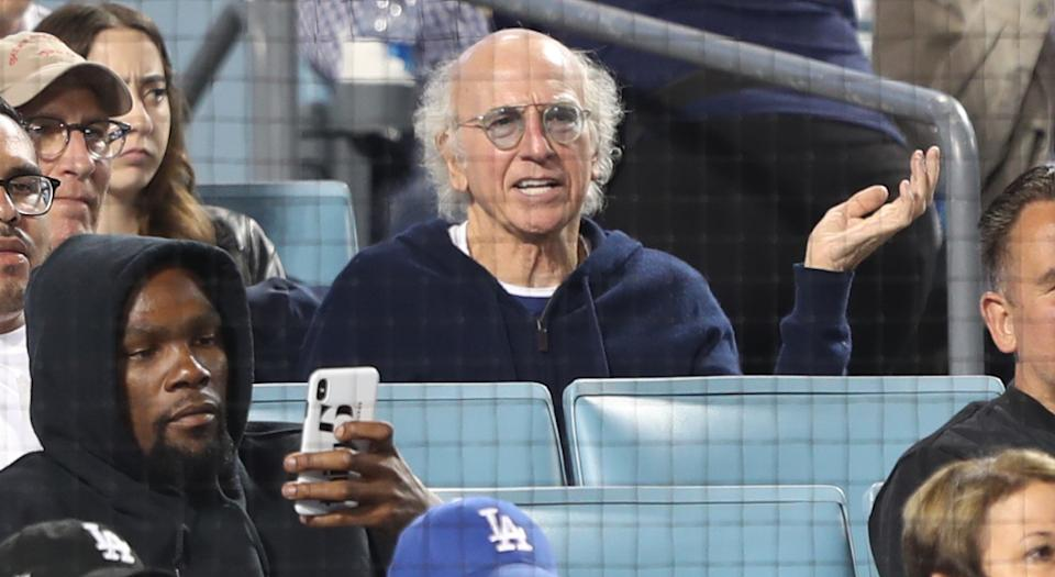 LOS ANGELES, CALIFORNIA - AUGUST 23: Kevin Durant (Bottom L) and Larry David (Top R) attend The Los Angeles Dodgers Game at Dodger Stadium on August 23, 2019 in Los Angeles, California. (Photo by Jerritt Clark/Getty Images)