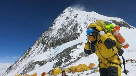 A porter carries goods at camp four at Everest