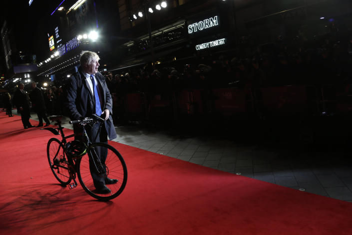 FILE - In this Tuesday, Oct. 14, 2014 file photo London mayor Boris Johnson poses for photographers upon arrival at the premiere of the film Testament of Youth, in London. (Photo by Joel Ryan/Invision/AP, File)