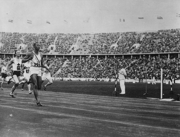 August 1936:  US athlete Jesse Owens (1913 - 1980) competing in a race during the Olympic Games at Berlin.  He won four gold medals at the Berlin Olympics, 100 metres, 200 metres, long jump and the 4 x 100 metres relay.  (Photo by Central Press/Getty Images) (Photo: Central Press via Getty Images)