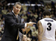 Purdue head coach Matt Painter, left, question a call against his player P.J. Thompson in the first half of an NCAA college basketball game against the North Carolina State in West Lafayette, Ind., Tuesday, Dec. 2, 2014. (AP Photo/Michael Conroy)