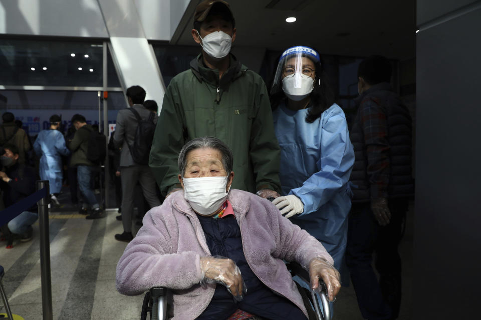 A South Korean elderly woman in a wheelchair arrives to receive the first dose of the Pfizer-BioNTech COVID-19 vaccine at a vaccination center in Seoul, South Korea, Thursday, April 1, 2021. South Korea started its coronavirus vaccination for senior citizens over 75 years old. (Chung Sung-Jun/Pool Photo via AP)
