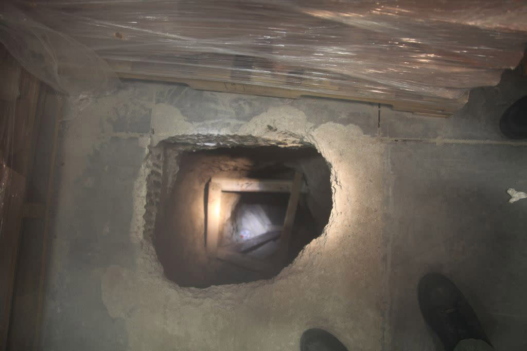 A view of the U.S. entrance to a 400-yard (370-meter) cross-border tunnel after authorities recovered 14 tons of marijuana from warehouses in Otay Mesa industrial park and Tijuana, Mexico, in Otay Mesa, California November 16, 2011. Police discovered the tunnel running to California from Mexico, and seized more than 17 tons (12,700 kilograms) of marijuana, U.S. and Mexican authorities said on Wednesday. U.S. federal agents made the discovery after police stopped a small cargo truck seen leaving a nondescript white warehouse building near the Otay Mesa port of entry on Tuesday afternoon, and arrested two men, U.S. Immigration and Customs Enforcement (ICE) agency said. REUTERS/Handout     (UNITED STATES - Tags: CRIME LAW DRUGS SOCIETY) FOR EDITORIAL USE ONLY. NOT FOR SALE FOR MARKETING OR ADVERTISING CAMPAIGNS. THIS IMAGE HAS BEEN SUPPLIED BY A THIRD PARTY. IT IS DISTRIBUTED, EXACTLY AS RECEIVED BY REUTERS, AS A SERVICE TO CLIENTS