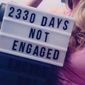 Woman's sign on how many days she hasn't been engaged