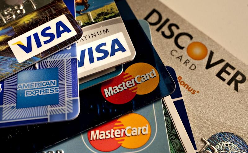 American Express, Discover, MasterCard and Visa credit cards are displayed for a photograph in New York, U.S., on Tuesday, May 18, 2010. (Getty)