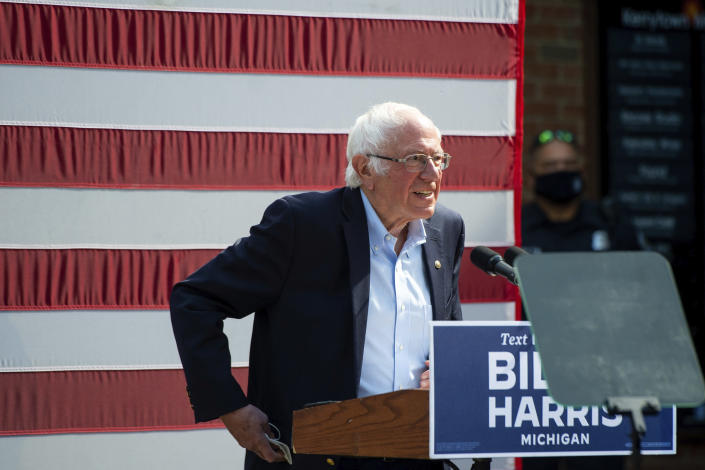 Vermont Sen. Bernie Sanders approaches the stage at Kerrytown Market in Ann Arbor on Monday, Oct. 5, 2020. Twenty-five people were permitted inside the socially-distanced rally, while a larger group gathered on the sidewalk outside. (Jacob Hamilton/Ann Arbor News via AP)