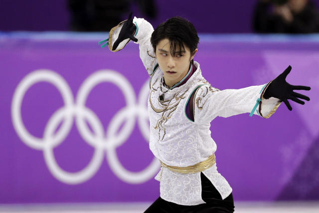 FILE - In this Feb. 17, 2018, file photo, Yuzuru Hanyu, of Japan, performs during the men's free figure skating final at the 2018 Winter Olympics in Gangneung, South Korea. Hanyu, the world's most popular figure skater, and American Nathan Chen, his biggest rival, face off at the Grand Prix Finals this week in Turin, Italy. (AP Photo/David J. Phillip, File)