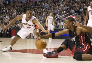 Uzoh (left) had a triple-double during his stay with the Raptors. (AP)