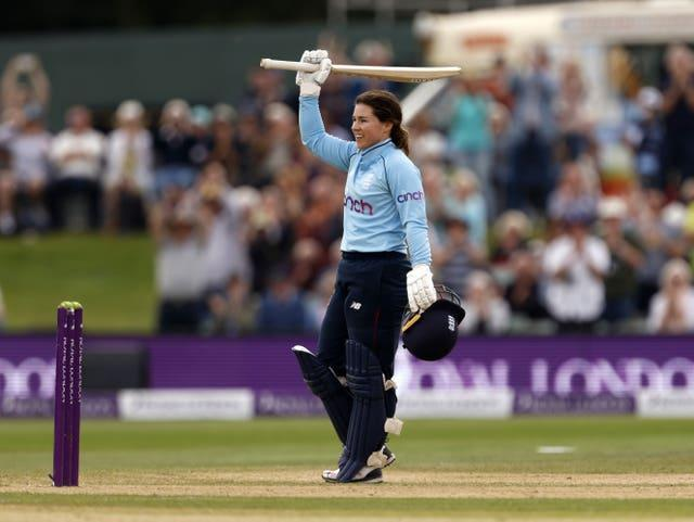 England's Tammy Beaumont raises her bat after scoring a century in the one-day international against New Zealand at Canterbury