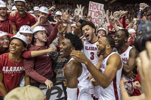 Alabama forward Alex Reese (3) and teammates join the Alabama student section to celebrate after an NCAA college basketball game against Auburn, Wednesday, Jan. 15, 2020, in Tuscaloosa, Ala. (AP Photo/Vasha Hunt)