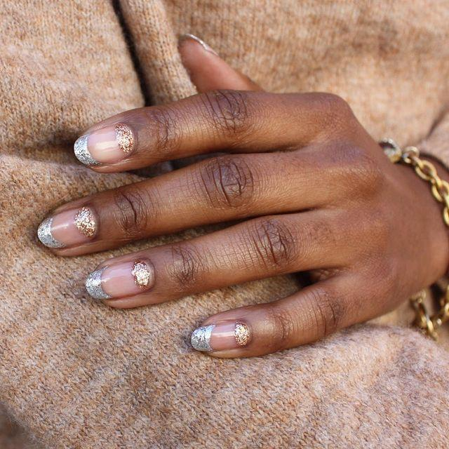 Mixing metals is one way to get into the festive spirt. Doing so with a negative space French mani looks modern, not over the top.