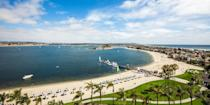"""<p><strong>Best Beach for Dogs </strong><br></p><p>Located in Mission Bay, <a href=""""https://go.redirectingat.com?id=74968X1596630&url=https%3A%2F%2Fwww.tripadvisor.com%2FAttraction_Review-g60750-d3531365-Reviews-Fiesta_Island-San_Diego_California.html&sref=https%3A%2F%2Fwww.redbookmag.com%2Flife%2Fg37132327%2Ftop-california-beach-vacations%2F"""" rel=""""nofollow noopener"""" target=""""_blank"""" data-ylk=""""slk:Fiesta Island"""" class=""""link rapid-noclick-resp"""">Fiesta Island</a> is just 15 minutes from downtown San Diego. The entirety of the island is a park, and much of it is leash-free for dogs. Your four-legged friends will love this large crescent-shaped beach, where they can run on the sand and small dunes, and cool off with a dip in the shallow bay waters. </p><p><strong><em>Where to Stay:</em></strong> <a href=""""https://go.redirectingat.com?id=74968X1596630&url=https%3A%2F%2Fwww.tripadvisor.com%2FHotel_Review-g60750-d1237001-Reviews-Hotel_Indigo_San_Diego_Gaslamp_Quarter-San_Diego_California.html&sref=https%3A%2F%2Fwww.redbookmag.com%2Flife%2Fg37132327%2Ftop-california-beach-vacations%2F"""" rel=""""nofollow noopener"""" target=""""_blank"""" data-ylk=""""slk:Hotel Indigo San Diego Gaslamp Quarter"""" class=""""link rapid-noclick-resp"""">Hotel Indigo San Diego Gaslamp Quarter</a>, <a href=""""https://go.redirectingat.com?id=74968X1596630&url=https%3A%2F%2Fwww.tripadvisor.com%2FHotel_Review-g60750-d628619-Reviews-The_Sofia_Hotel-San_Diego_California.html&sref=https%3A%2F%2Fwww.redbookmag.com%2Flife%2Fg37132327%2Ftop-california-beach-vacations%2F"""" rel=""""nofollow noopener"""" target=""""_blank"""" data-ylk=""""slk:The Sofia Hotel"""" class=""""link rapid-noclick-resp"""">The Sofia Hotel</a></p>"""