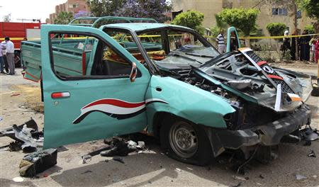 A damaged car of Brigadier General Ahmed Zaki, who was killed in explosion outside home, is pictured in 6th of October City