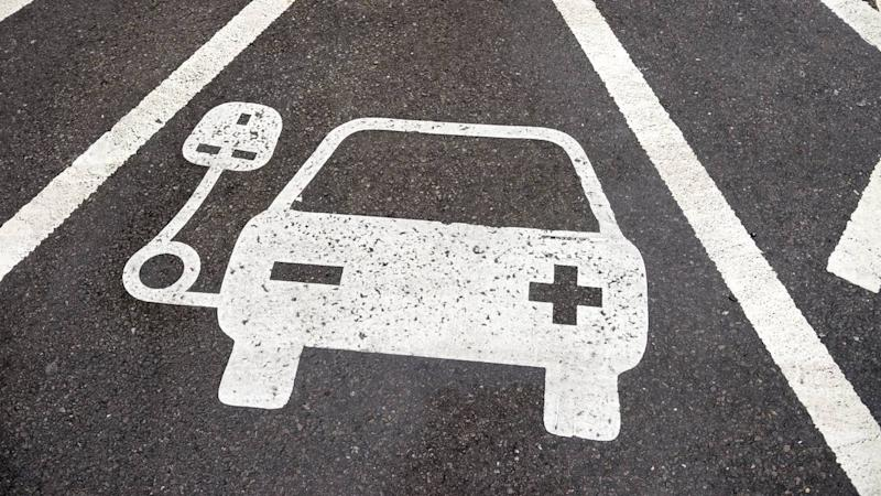 Electric vehicle charging station sign in parking bay