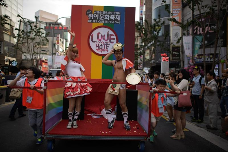 Members of the LGBT community take part in a Gay Pride parade in Seoul in 2014 (AFP Photo/Ed Jones)