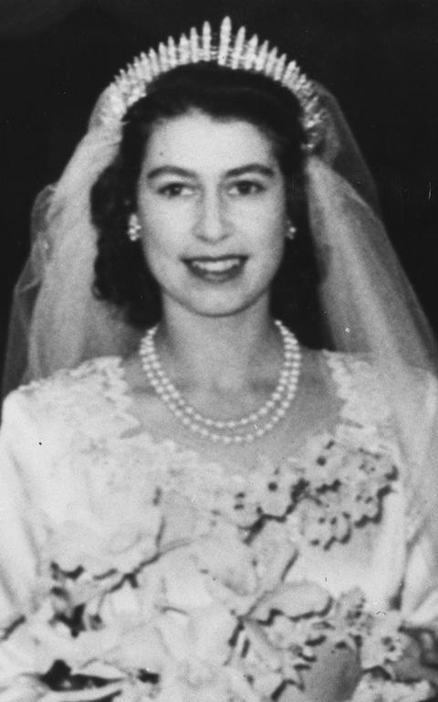 The Queen on her wedding day in 1947 wearing the diamond Fringe tiara and a double-strand pearl necklace - Credit: Topical Press Agency/Getty Images