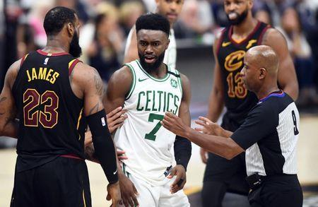 May 25, 2018; Cleveland, OH, USA; Boston Celtics guard Jaylen Brown (7) reacts after a play against Cleveland Cavaliers forward LeBron James (23) during the fourth quarter in game six of the Eastern conference finals of the 2018 NBA Playoffs at Quicken Loans Arena. Mandatory Credit: Ken Blaze-USA TODAY Sports
