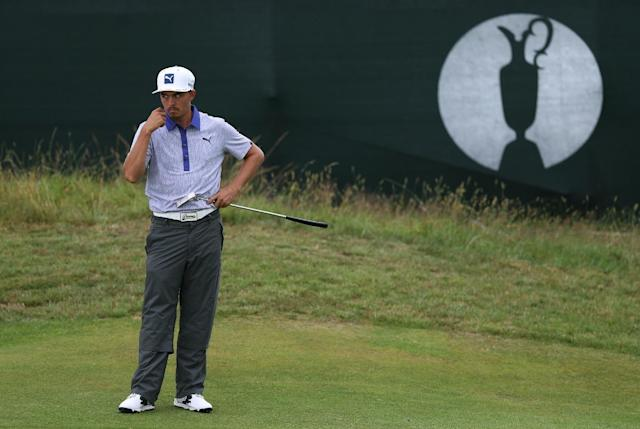 Rickie Fowler of the US waits to putt on the 15th green during the third day of the British Open Golf championship at the Royal Liverpool golf club, Hoylake, England, Saturday July 19, 2014. (AP Photo/Scott Heppell)