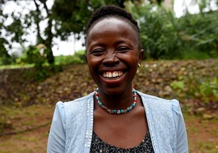 School teacher, Nancy Gbamoi, smiles outside a hotel, after becoming the first person in the country to apply for an online ID database in credit system, in Freetown
